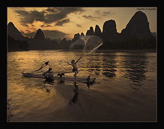 Balancing Life and Survival (Ragstatic) Tags: world life china travel light sunset people fish heritage net nature river li nikon exposure view earth rags quality culture fishnet scene ng publication nationalgeographic subtle guangxi xingping d700
