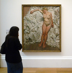 Woman Looking at Lucian Freud's Standing by the Rags at Tate Britain