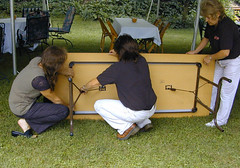 Mari sets up a table