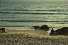 Fisherman waiting (trazmumbalde) Tags: sea beach portugal fisherman waiting rocks warm europe waves matosinhos endofday segulls nohorizon thechallengefactory