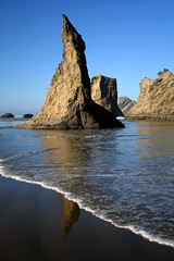Bandon Needle (wavesandwaterfalls) Tags: ocean reflection nature water oregon canon sand rocks waves shoreline scenic pacificocean pacificnorthwest incomingtide bandon needles canondslr rockformations seastacks bandonbythesea bandonoregon blueribbonwinner centraloregoncoast specnature scenicwater anawesomeshot diamondclassphotographer oregonsadventurecoast goldstaraward natureselegantshots