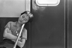 Image of a woman sleeping on a subway courtesy of Max3270