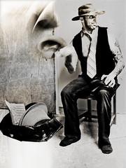 The sun did not shine. It was too wet to play. So we sat in the house on that cold, cold, wet day.  We looked! Then we saw him step in on the mat! We looked! And we saw him! The pimp in the cowboy hat!* (pimpdisclosure) Tags: door bw white motion black texture kitchen tattoo trash chair cowboy ryan tie fedora vest pimp wildwest pseudo thewildwest pimpexposure pseudoexposure thehatchronicles pimptimes cowboypimp nofedoraswereharmedinthemakingofthisphotograph warningweareprofessionalspecialtytrainedhatexpertsdonottrythishatstuntathome thelastoneinthecommentscracksmethefuckupeverytimeilookatittoobaditscompositionallyretarded nextshotpostedwillbe365iswear howmanyfedorascanyoufindinthisphototherearelessthan10