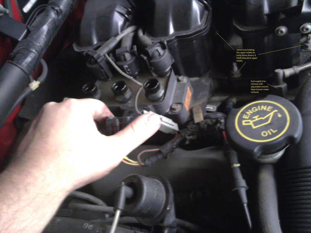 How To Replace Valve Cover Gaskets Fuel Rail And Lower Ford F150 Battery Terminal Disconnect Negative You Dont Want Damage Any Sensors Or The Pcm 2 Remove Rubber Hose That Connects Oil Fill Neck On