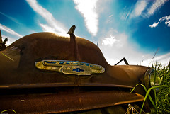The world is everlasting (Brian U) Tags: blue sky clouds rust scrapyard puffy corrosion wispy calgaryflickrmeetscrapyard june2007flickrmeet