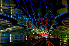Goodbye Chicago (Ramon2002) Tags: blue windows light red usa chicago abstract glass lines airplane michael airport neon steel 1987 curves tunnel ohare hayden ohareinternationalairport 5photosaday skysthelimit colorphotoaward travelerphotos ramon2002