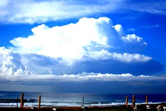Close to summers end (catgotti) Tags: beach clouds indianocean umbrellas rollingin