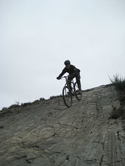 Dave rides the big rock face at Wolftrax in Laggan Scotland
