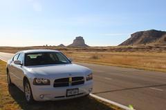 My cool rental car and the western Nebraska skyline (Hazboy) Tags: usa west monument america us midwest nebraska rocks native indian great national american valley dodge navajo plains scotts charger bluff reservation scottsbluff hazboy hazboy1