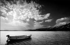 In mezzo al mare (alessandra mogorovich) Tags: sea blackandwhite clouds boat dock barca nuvole mare horizon chain mooring molo biancoenero digitalinfrared catena supershot ormeggio orrizzonte abigfave anawesomeshot diamondclassphotographer blackribbonbeauty