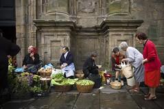 Street sellers (trazmumbalde) Tags: street santiago people vegetables spain europe galicia santiagodecompostela jesters sellers outstandingshots nikonstunninggallery beginnerstreetphotography photooftheday26jun2007 fiveflickrfavs cyspecialchallengewinner