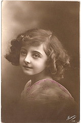 sad-eyed girl (rosewithoutathorn84) Tags: girl beautiful sepia vintage bigeyes pretty child sad belgium postcard serene angelic curlyhair edwardian