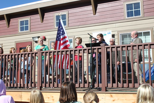 Students recite the Pledge of Allegiance at the start of a ceremony for the new school project