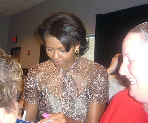 Michelle Obama Gives an Autograph
