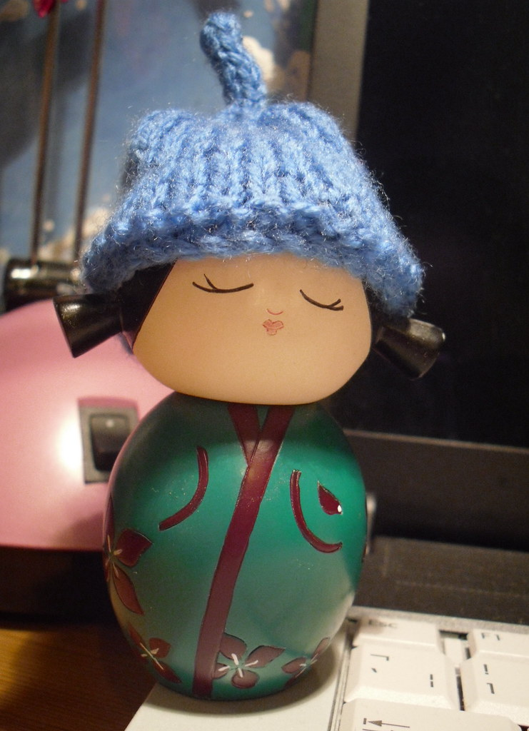 knitted hat on kokeshi
