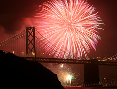 Bay Bridge Fireworks (Rob Kroenert) Tags: sanfrancisco california bridge red usa night island bay san francisco long exposure treasure treasureisland fireworks kaboom baybridge area kfog