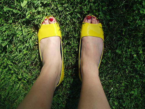 Yellow shoes on grass