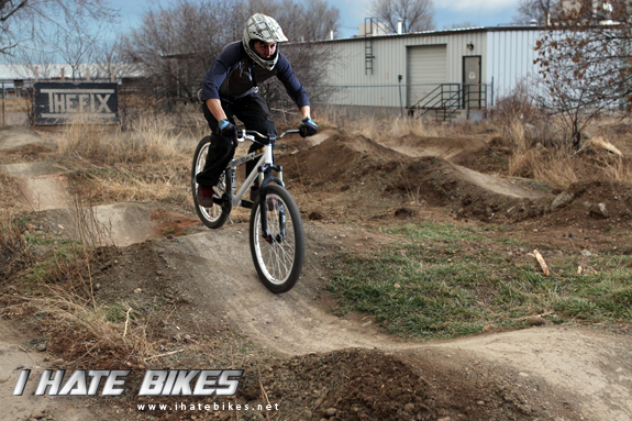 Pumping through the rollers; check out the sign in the background that doubles as a wallride.