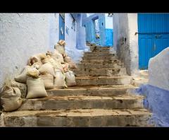 stairs........ (atsjebosma) Tags: blue stairs blauw doors steps morocco maroc flour chefchaouen trap oldcity marokko farine deur sacks meel zakken supershot trede mywinners atsjebosma alwaysexc