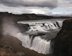 Double Cascade(or The FALL) (Gay Biddlecombe) Tags: mountains history water clouds waterfall iceland rocks dam falls spray cascade gullfoss