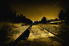 Shooting star (-liyen-) Tags: longexposure d50 nightshot perspective surreal nikond50 railwaytrack interestingness18 outstandingshots flickrsbest cy2 challengeyouwinner flickrchallengewinner classwithdaves cwd232 cwdbs mycontactlenspoppedouthere itwashardtofindinthedark ifounditsoicoulddrivehomeafterall cwdbs23 fiveflickrfavs