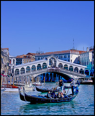 Grand Canal, Venice (say.fromage) Tags: city bridge blue venice houses homes sea vacation sky people italy holiday rialtobridge cold water weather shop canon boats town canal grande europe italia 300d colours canon300d restaurants talk grand bluesky tourists eat shops gondola dine 1855 venezia grandcanal rialto canale cityonwater flickrsbest abigfave