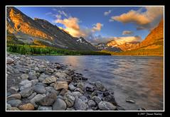 New Light (James Neeley) Tags: lake mountains sunrise bravo lakes glacier glaciernationalpark hdr naturesfinest manyglacierhotel swiftcurrentlake supershot magicdonkey 5xp flickrsbest abigfave anawesomeshot goldenphotographer jamesneeley photomiami lightstylus