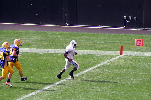 some guy running to make a touchdown
