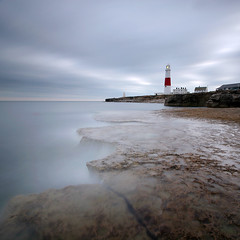 Portland Bill Dusk (Adam Clutterbuck) Tags: ocean uk longexposure greatbritain sunset sea england mer lighthouse seascape colour water rock stone clouds square portland landscape eau surf sundown cloudy unitedkingdom britain dusk pavement dorset gb sq weymouth phare oe portlandbill ocan longueexposition shorescape longuepose greengage adamclutterbuck showinrecentset openedition