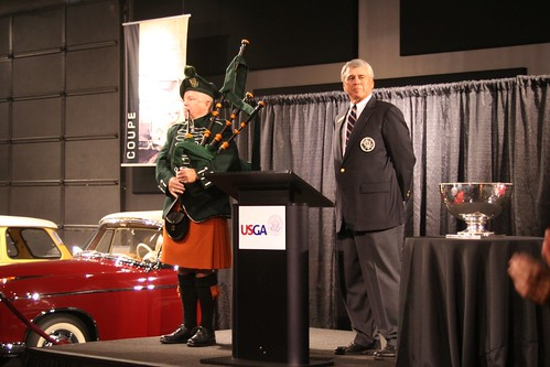 Pat McKinney with the bagpiper