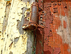 Hand-tooled hardware (Texas Finn) Tags: door hinge wood old red abandoned stain yellow hardware rust peeling paint doors texas decay nail rusty flake historic stained nails forgotten rusted ghosttown weathered peelingpaint flakes flaking crusty dilapidated townsquare nailed blueribbonwinner