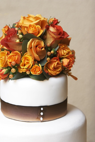The top of a fancy wedding cake with flowers