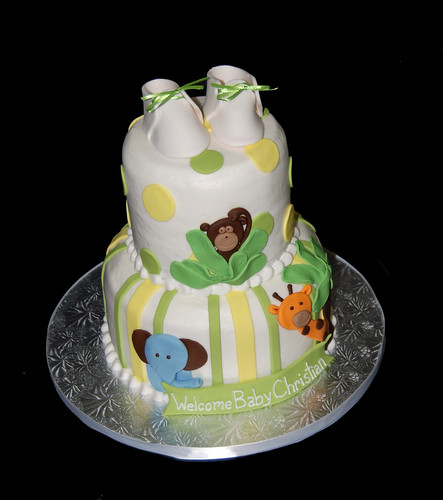 yellow and green jungle animal giraffe monkey and elephant baby shower cake