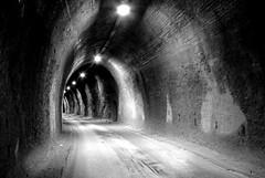 (Stranju) Tags: strada tunnel luci buco montagna bianco nero galleria antro biancoenero ecc scuro curva marmo profondo bwdreams colonnata lucisoffuse abigfave superaplus aplusphoto blackandwhitephotoaward sfidephotoamatori versionebn 332il12giugno2007 youvegottheeye