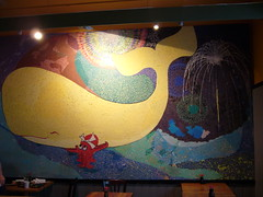Sushi bar ki-mama, wall painting of an octopus carrying a whale