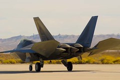 F-22 (aaron_j_o) Tags: usa mountain mountains wings fighter unitedstates taxi military unitedstatesofamerica hill wing jet engine cockpit hills airshow raptor mission f22 wingspan taxiway afterburner fighterjet f22raptor