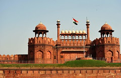 The Indian flag flying over Delhi Gate () Tags: city vacation india holiday architecture design gate fort flag delhi capital entrance exit rtw vacanze newdelhi roundtheworld mainentrance redfort indianflag globetrotter lalqila republicofindia delhigate lahoregate worldtraveler 22days lalqilah theredfort