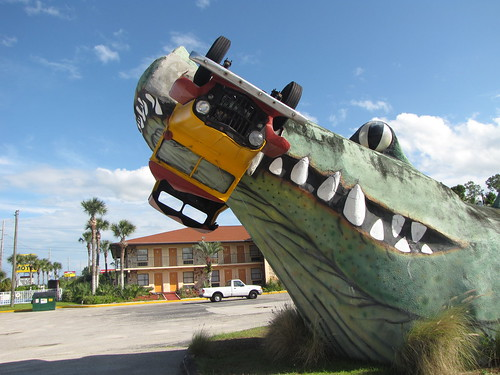 Giant gator crushing a jeep