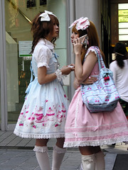 Pink Lolitas (Roving I) Tags: costumes streets japan ribbons lace dresses osaka uniforms conversations bows maids whitesocks cellphones frills