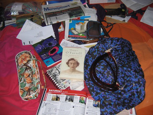 Knitting bags and books on our bed