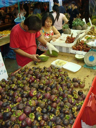 The fruit vendor and a pile of wonderful mangosteen