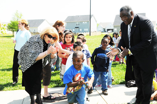 "Dr. Lynn Harvey with NC Department of Public Instruction Child Nutrition Services and Southeast Regional Administrator Donald Arnette with USDA Food and Nutrition Service encourages Thomasville Primary School students in the ""strawberry in the spoon"" race as part of the school's Let's Move program inspired by First Lady Michelle Obama (USDA photo by Debbie Haston-Hilger)"
