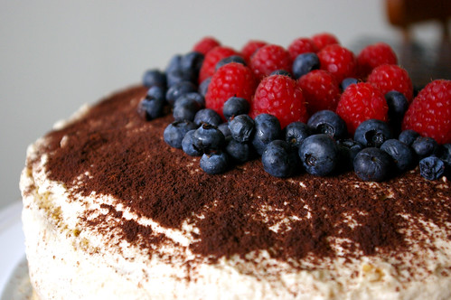 Tiramisu cake topped with berries
