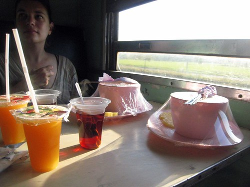 Train breakfast - rice soup and tea and very strange OJ