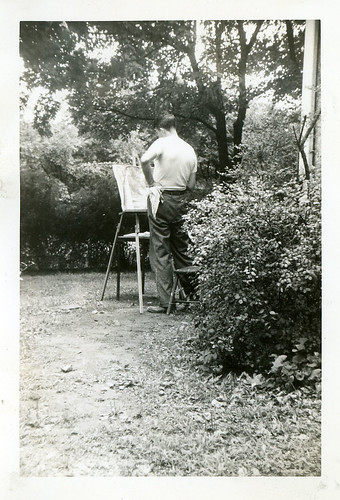 Vintage photo, man painting in his backyard