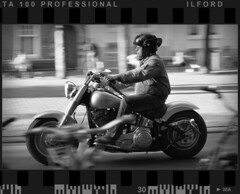Easy Tracker (Edd Noble) Tags: bw motion amsterdam bike nikon bikes f100 motorcycle delta100 nikkor panning ilford tracking 85mmf14d epsonv700