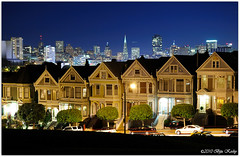 Postcard Row at Night (Explore) (Biju Koshy) Tags: sf sanfrancisco old houses classic architecture night lights view shot nightshot scenic nighttime fullhouse victorianhouses paintedladies lightstreak postcardrow colorfulhouses alamosquarepark 710720steinerstreet edwardwardianhouses