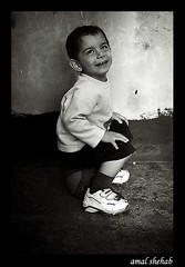 TWINKLE TWINKLE LITTLE SMILE (amal shehab) Tags: portrait blackandwhite lebanon playing smile basketball happy kid sitting child amal joy young happiness innocence beirut shehab toiletlike amalshehab