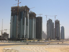 Construction City (StewieD) Tags: city architecture buildings construction dubai skyscrapers desert uae cranes emirates constructionsite unitedarabemirates assignment2 sharedurbanspace