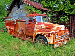 Where's the fire? (Texas Finn) Tags: old roof reflection overgrown barn truck weeds texas display palestine rusty storage bin mirrror prize parked fireengine rearview windshield spout corrugated blueribbonwinner platinumphoto chireno